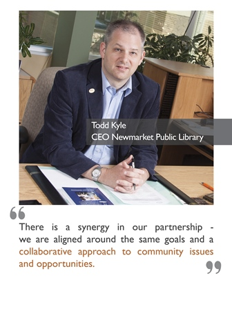 Todd Kyle, CEO of the Newmarket Public Library, sitting at a desk with his hands folded.